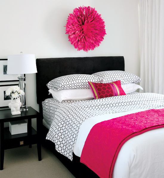 Pretty in pink Pops of hot pink are what make this small space bedroom stand out from the rest, from the feather wreath above the headboard to the bed accessories.