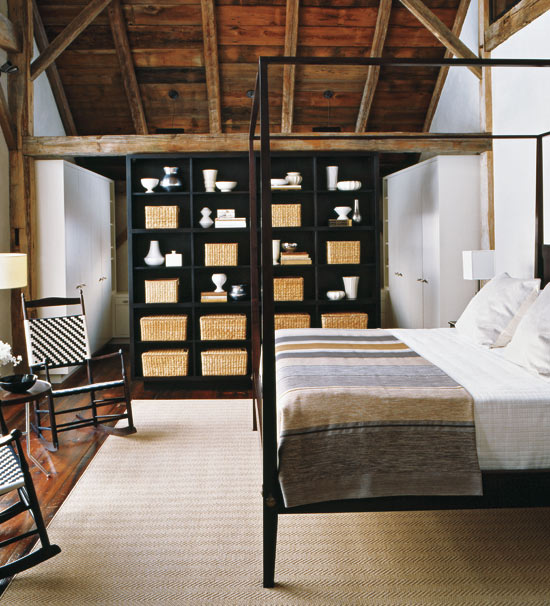 Rustic renovated barn By far one of our favourite interiors, this master bedroom is housed in a renovated barn that was moved from Canada to Connecticut. With high-beamed ceilings and a simple four-poster bed overlooking a wall of windows, this is the perfect place to snuggle on a cold winter's day.