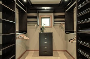 Stylish-Dark-Black-Walk-in-Closet-Designs-in-Modern-with-Darkwood-Furniture-Applied-Open-Storage-and-Hanger-also-with-Chest-of-Drawers