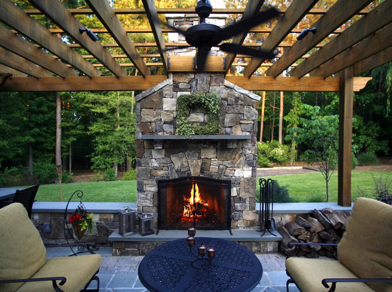Creating an outdoor living space for Back to back indoor outdoor fireplace