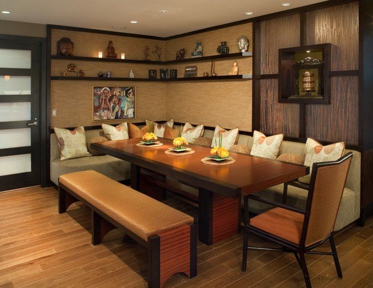 A long banquette accented with pillows provides a comfortable dining experience