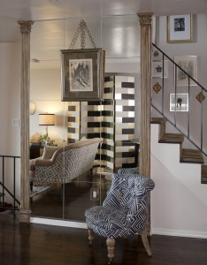 A tall mirror reflects the room, adding visual interest