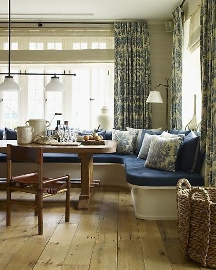 A comfortable banquette by the window invites family and guests to linger