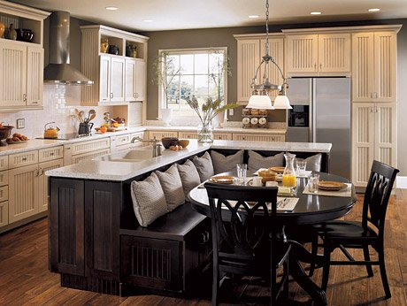 A banquette built in against the kitchen island is convenient and takes advantage of empty space
