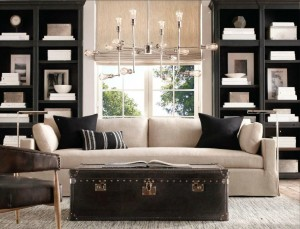 Bookshelves frame the window and create a symmetrical display area for artwork