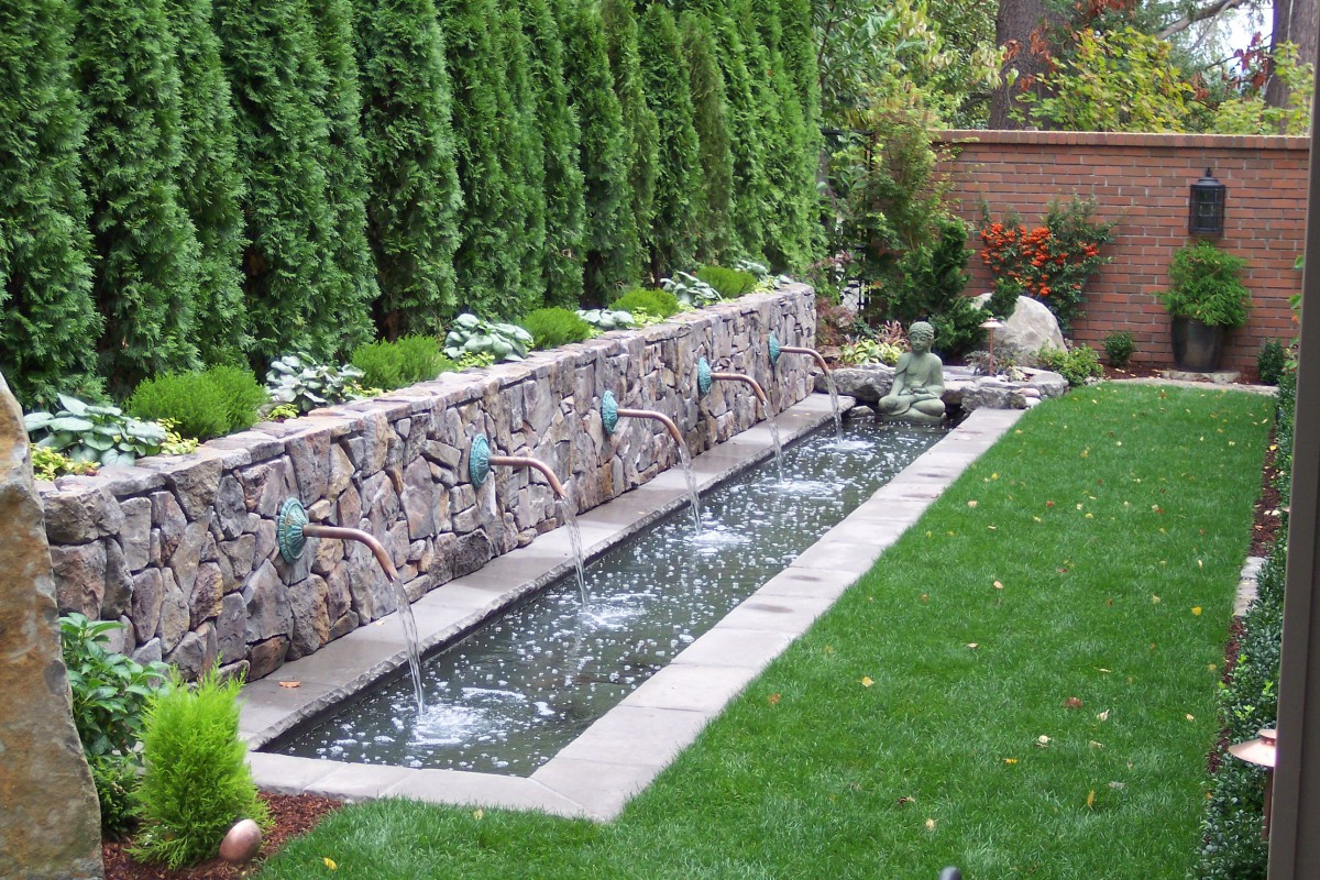 Relax with a backyard water feature - How to build an outdoor fountain with rocks ...