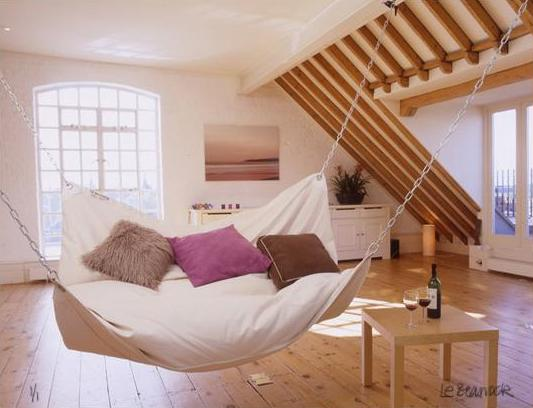 How to use an interior hammock in your bedroom for Living room hammock