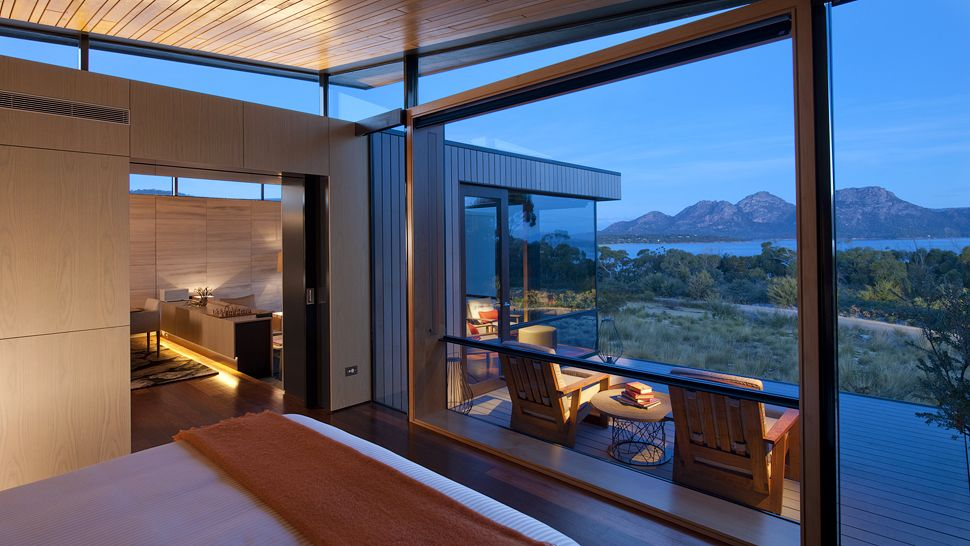 Amazing Mountain View Windows #1: Suite-bedroom-large-windows-patio-mountain-view-dusk