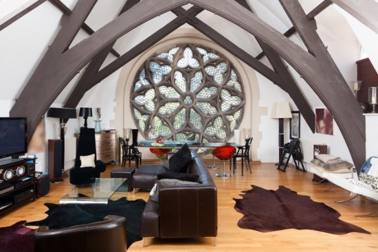 Stunning window highlights this loft area in a converted church