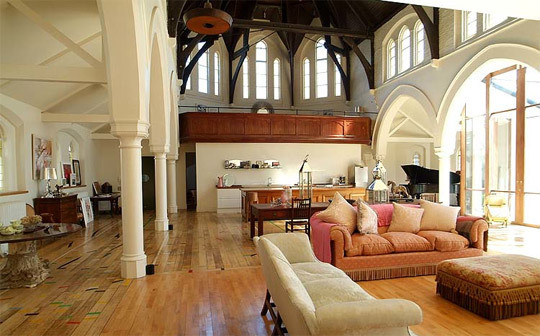 Beautiful wood beams and arches accent this church to home conversion