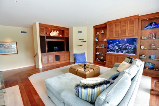 An aquarium is the feature of this family room