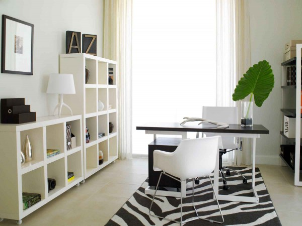 Shelving and a vivid rug add personalization to this office space