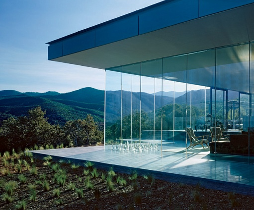 The unique architectural style of a glass house for Mountain home glass