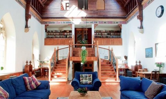 A loft area serves as a library in this converted church