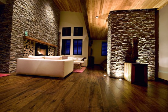 Stonework accents the wood floor and ceiling