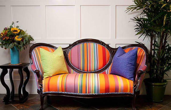 A vibrant modern stripe looks fresh on this Victorian sofa