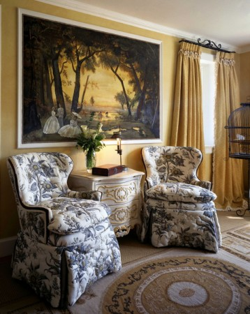A pair of chairs upholstered in quilted toile