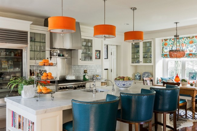 Orange light shades pop in this kitchen