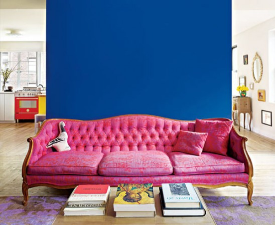 The blue wall offsets the pink sofa