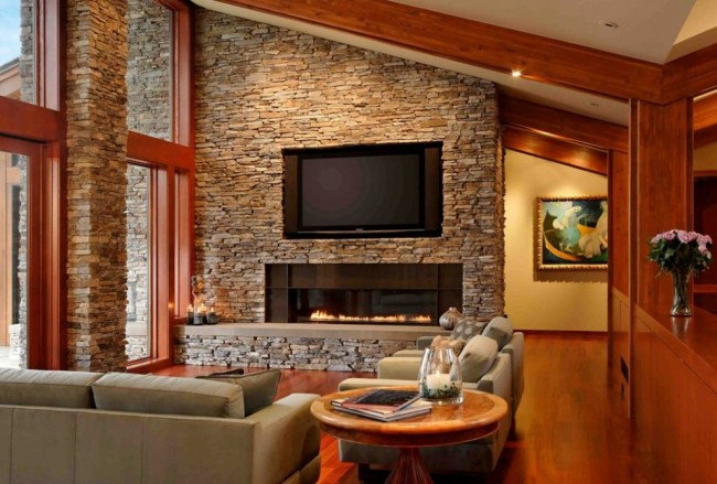 A fireplace wall with stone accents