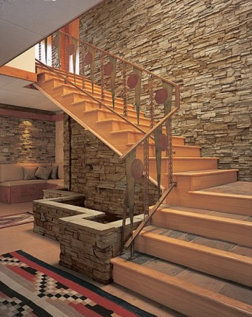 This staircase is accented with stone walls and structures (giesendesign)