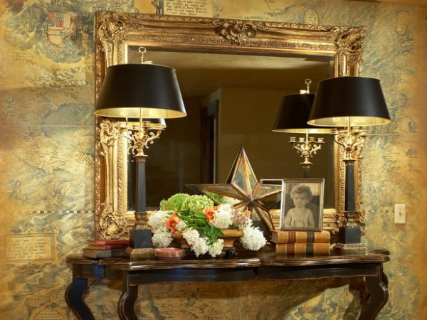 A beautiful mirror and lamps accent this foyer table