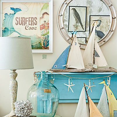 Sail boats, glass and seashells accents fit well in the coastal cottage