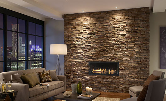Stacked stone fireplace surround in contemporary space