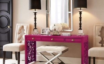 Console table adds a pop of color in this foyer