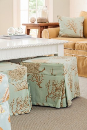 Ottomans covered in a pretty sea-life pattern add color and function