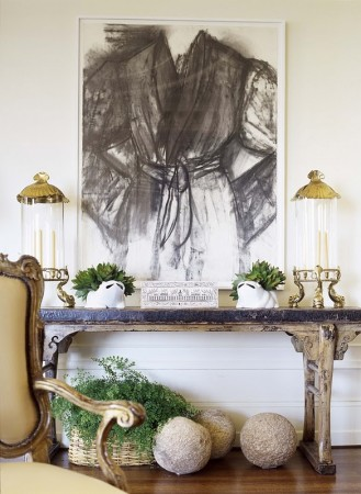 A piece of artwork accents this console table