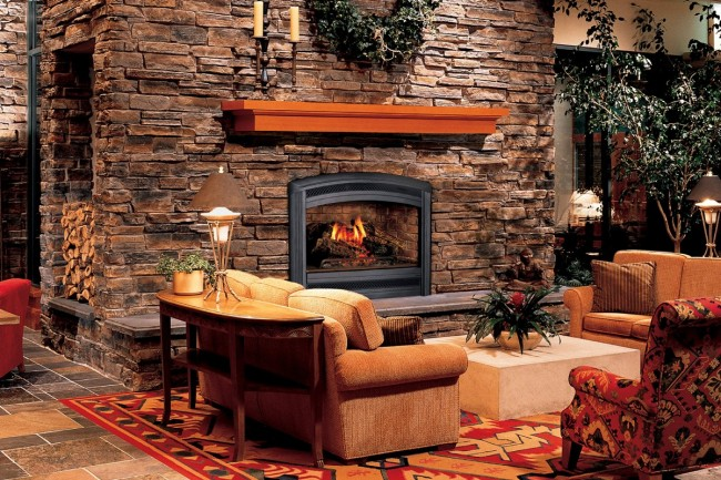 Beautiful stonework fireplace surround adds warmth and character