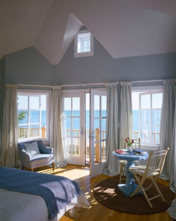 Loose curtain panels for this beach cottage