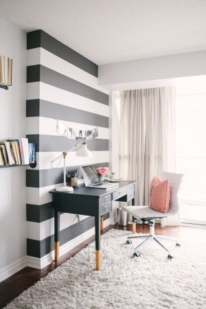 Paint one wall in a stripe pattern to add pizazz to a room