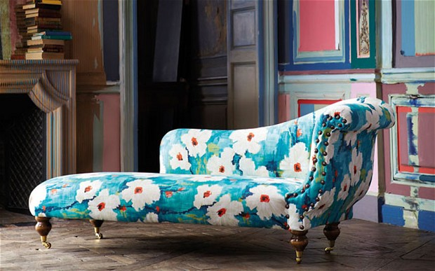 A modern floral print adds character to this chaise lounge