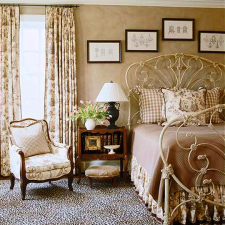 A bedroom accented with touches of toile