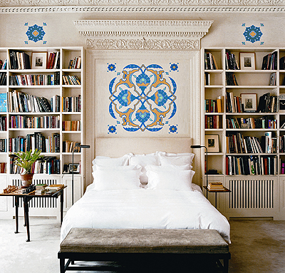 Bookcases flank a bed