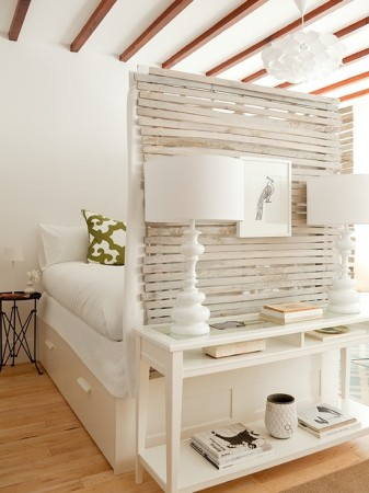 Placing a wall between the bed and room for added effect