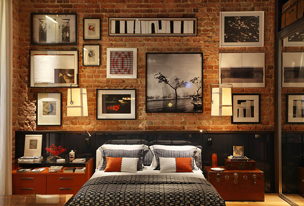 A display of photographs on the bed wall
