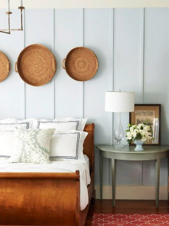 Simple baskets add charm to this bed wall