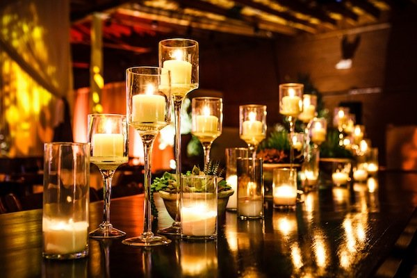 A group of candles gives a warm glow at the table