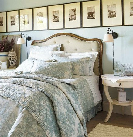 A grouping of prints across the bed wall add character and style to the bedroom