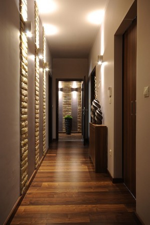 Sconces illuminate a hallway with style