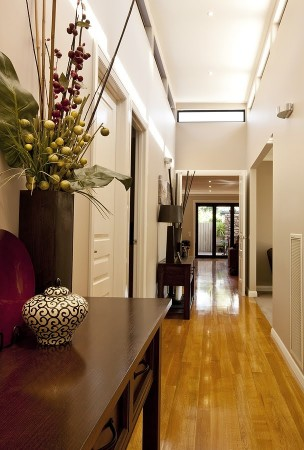Enhance a wider hallway space with a table