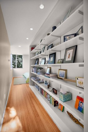 Shelving adds extra storage and display space to the hallway