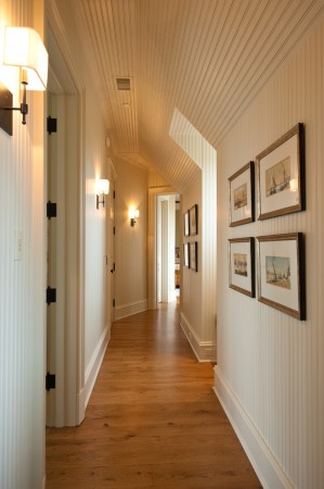 Sconces help illuminate this hallway