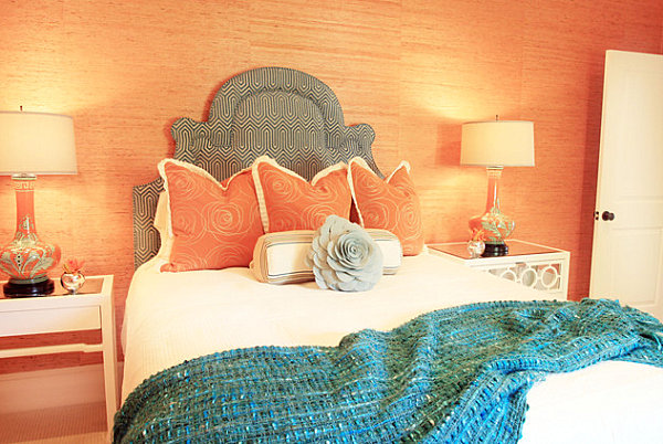 Soft coral walls accent this bedroom, while a beautiful aqua throw provides contrast