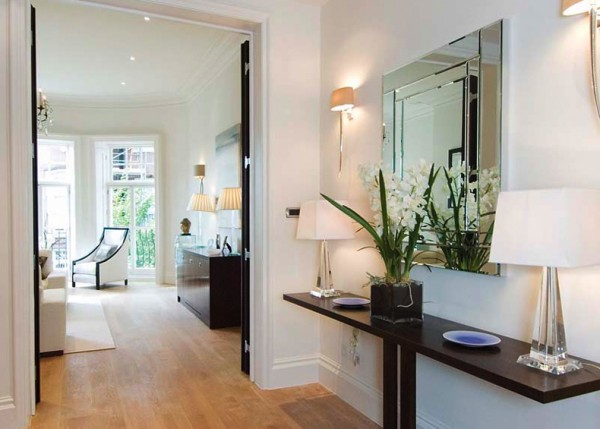 A narrow table and mirror perfect for the hallway