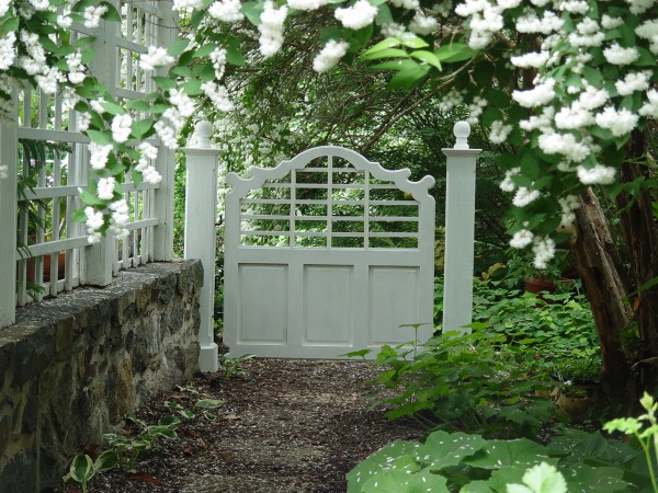 A pretty garden gate makes an entrance appealing
