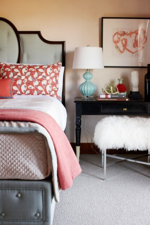 Soft colors of aqua and coral in this chic bedroom